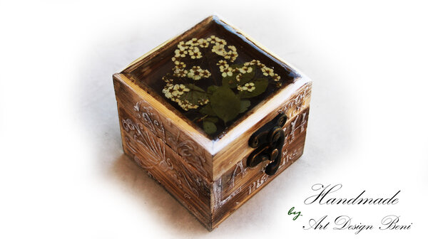 Aged, art, wooden box with a lid of jewelry resin.